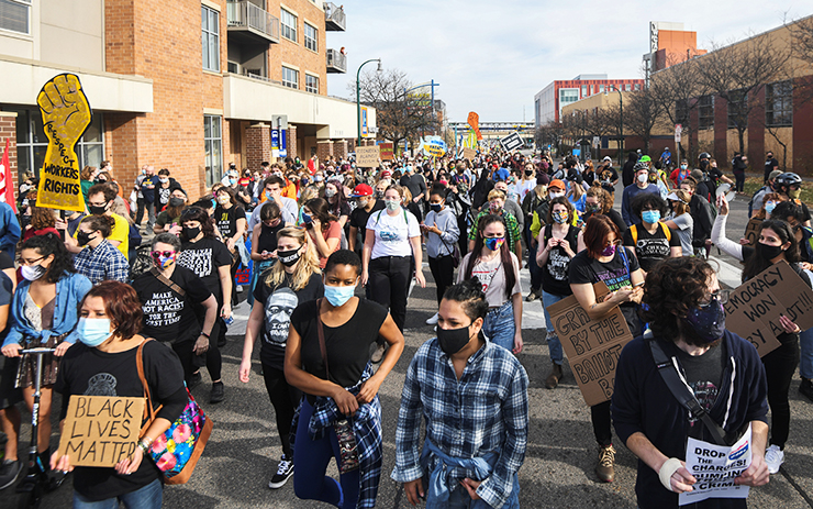 People marching in Minneapolis celebrating the announcement that Joe Biden will be the 46th president of the United States.