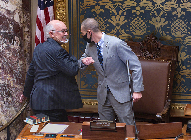 State Sen. Jeremy Miller, right, congratulating state Sen. David Tomassoni, left, after he was elected President of the Senate on Thursday.