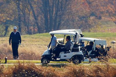Trump golfing