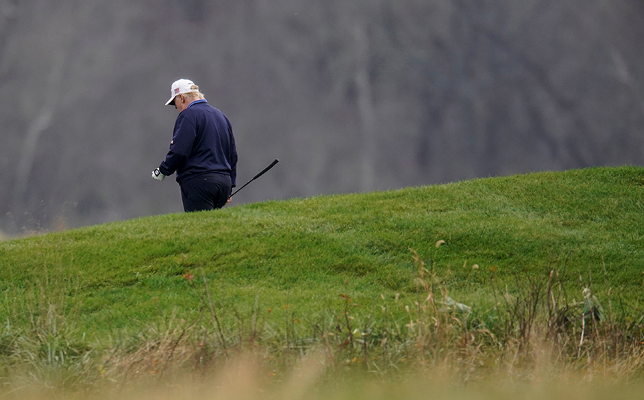 President Donald Trump playing golf at the Trump National Golf Club in Sterling, Virginia, on Sunday.