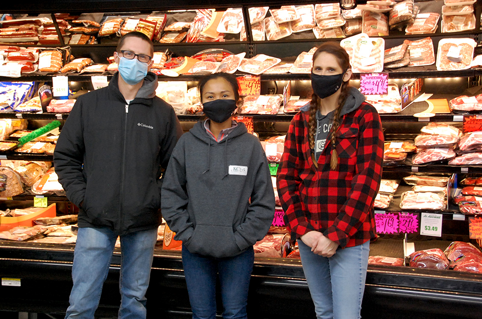 Owners of KC's Country Market in Greenbush, Corey Christianson and Ket Christianson, with employee Kelly Christianson.