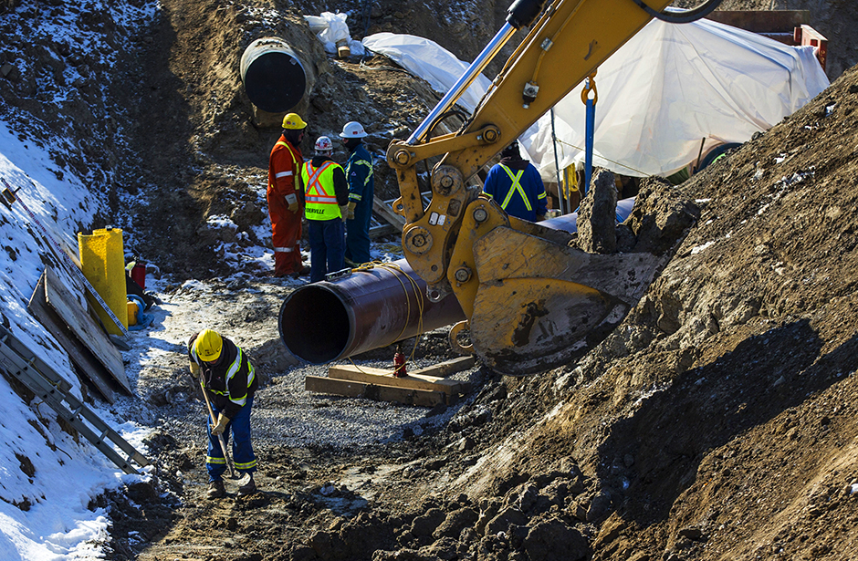 An Enbridge oil pipeline shown being worked on in East Don Parkland in Toronto, on March 6, 2014.