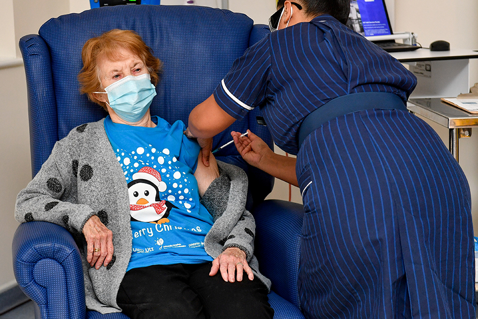 Margaret Keenan, 90, is the first patient in Britain to receive the Pfizer/BioNtech COVID-19 vaccine at University Hospital in Coventry, Britain, on Tuesday.