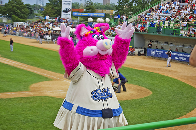 Mudonna leading a cheer during a 2009 Saints game at Midway Stadium.