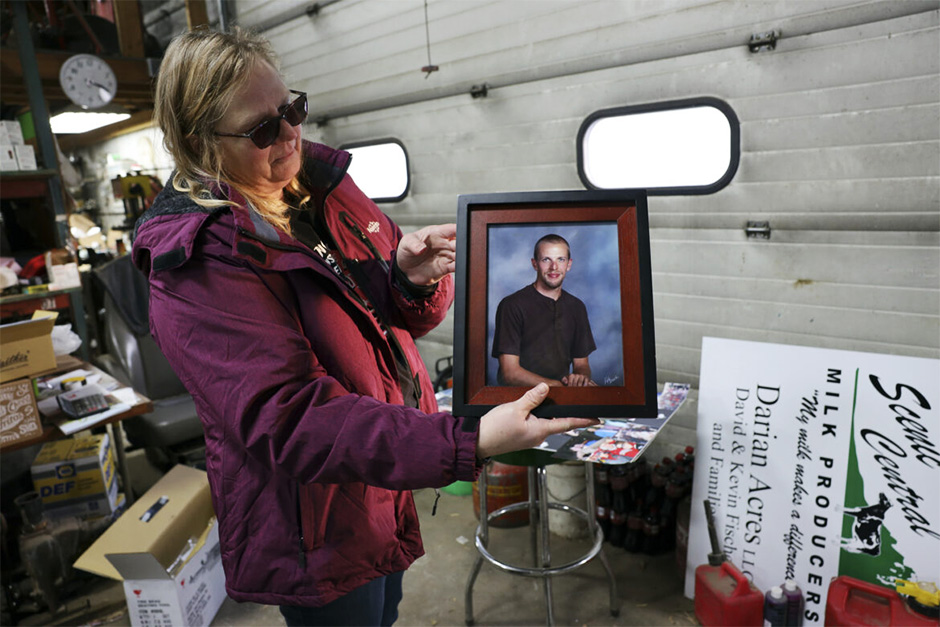 Amy Fischer is seen with a photo of her son, Brian. Brian died by suicide at the age of 33, on Dec. 21, 2016.