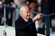 President Joe Biden pointing at attendees