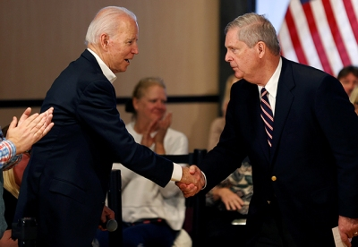 Biden shaking hands with former Iowa Gov. Tom Vilsack