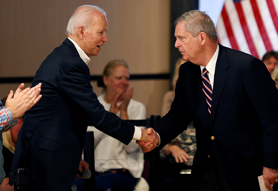 Former Vice President Joe Biden shaking hands with former Iowa Governor Tom Vilsack during a campaign event in Newton, Iowa, on January 30, 2020.