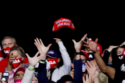 President Donald Trump supporters trying to catch a hat during a campaign event in Fayetteville, North Carolina, on September 19, 2020.