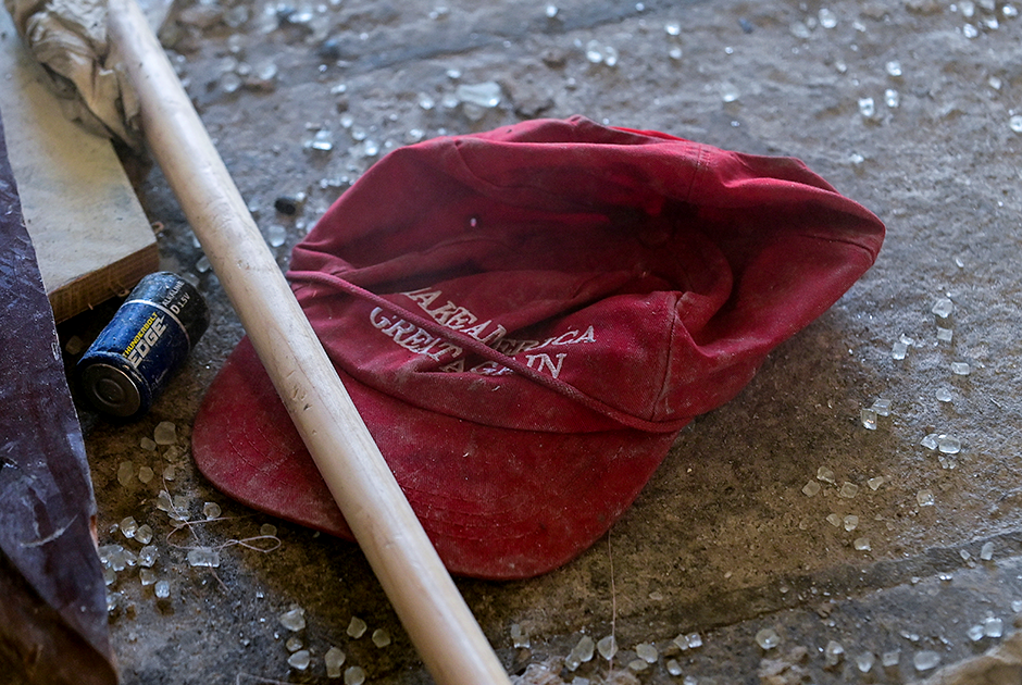 """A """"Make America Great Again"""" campaign cap sits in the debris left behind at the West Terrace entrance checkpoint of the U.S. Capitol a day after supporters of President Donald Trump stormed the Capitol."""