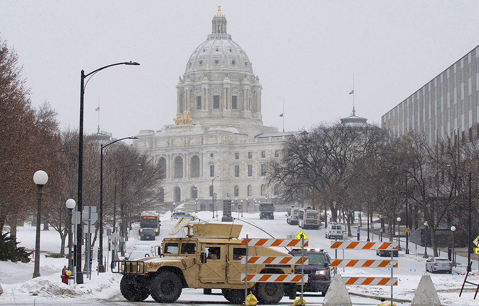 """A National Guard armored vehicle blocks off a street on the south side of the Minnesota State Capitol on January 19. Security has been heightened after the riot at the U.S. Capitol and the """"Storm the Capitol rally"""" at the Minnesota State Capitol on January 6."""