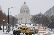 A National Guard armored vehicle blocks off a street on the south side of the Minnesota State Capitol on January 19.