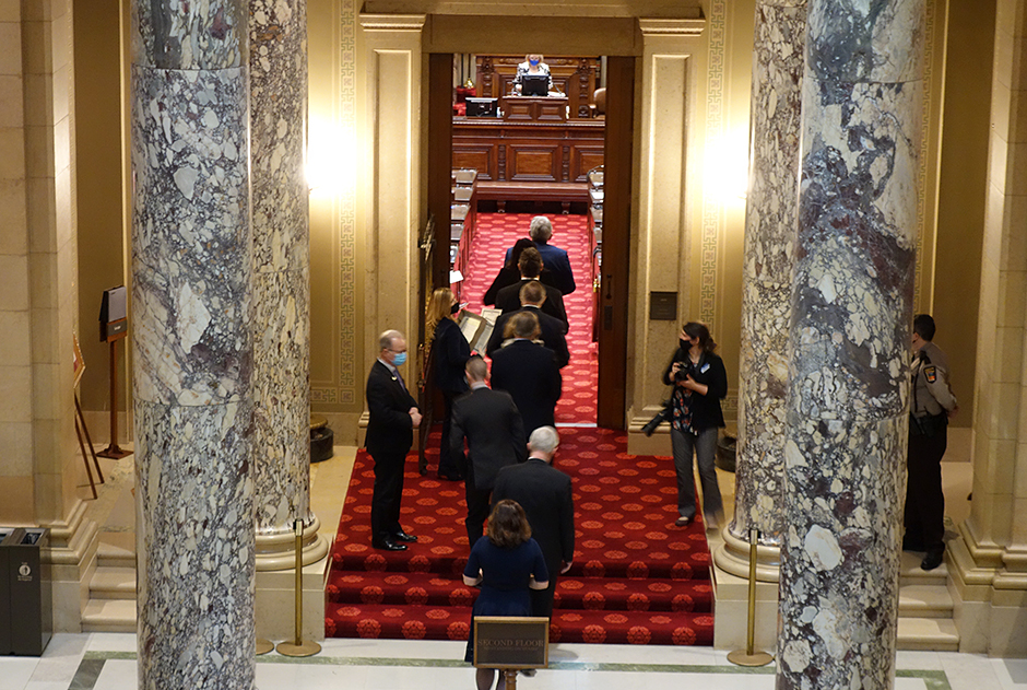 State senators entering the Minnesota Senate chambers on the first day of the 2021 legislative session.