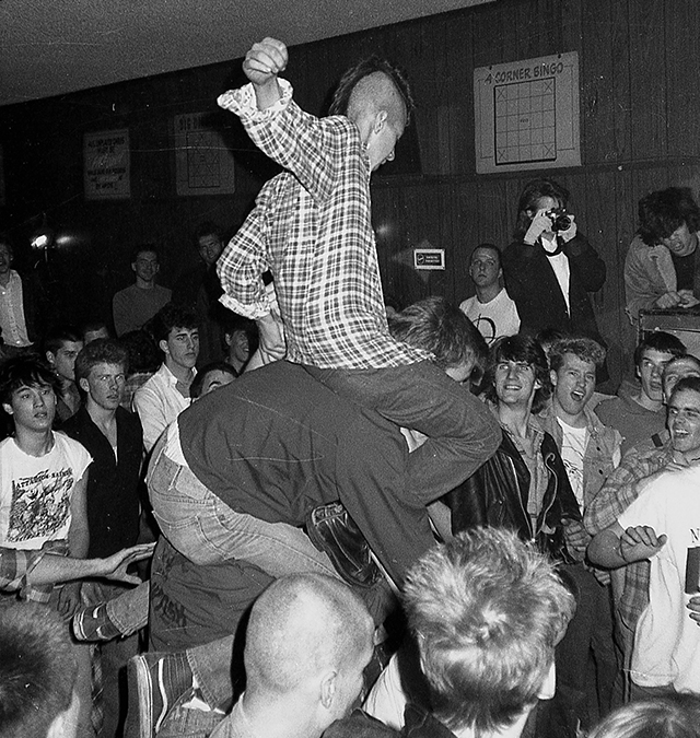 """Fifteen-year-old """"Minnesota Hardcore"""" producer David Roth chicken-fights his way through a Minor Threat show."""