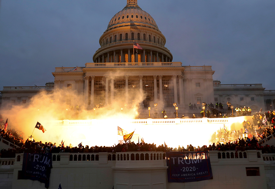 An explosion caused by a police munition is seen during the riot at the U.S. Capitol Building on Wednesday.