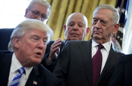 Then-Defense Secretary James Mattis looking at President Donald Trump