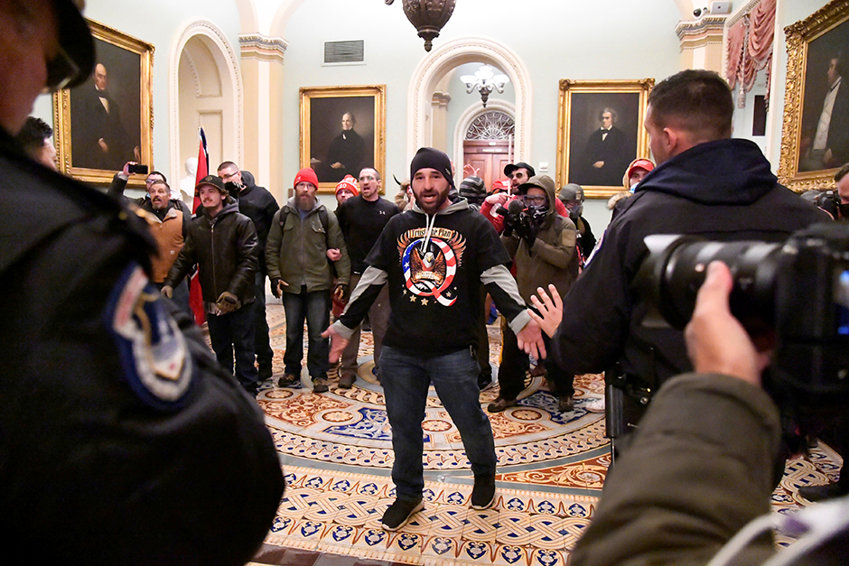 Rioters in support of President Donald Trump confronting police on the second floor of the U.S. Capitol near the entrance to the Senate on Wednesday.