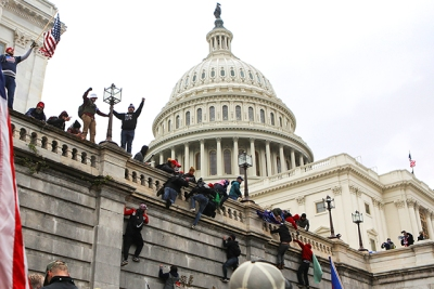 Supporters President Donald Trump climb on walls at the U.S. Capitol, rioting against the certification of the 2020 U.S. presidential election results.