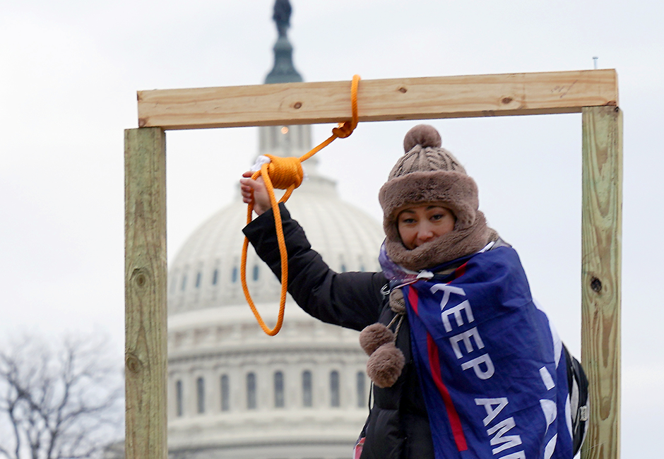 A supporter of President Donald Trump holding a noose outside of the U.S. Capitol Building on Wednesday.