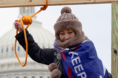 A supporter of President Donald Trump holding a noose