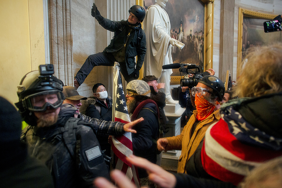An image of pro-Trump rioters storming the U.S. Capitol on January 6.