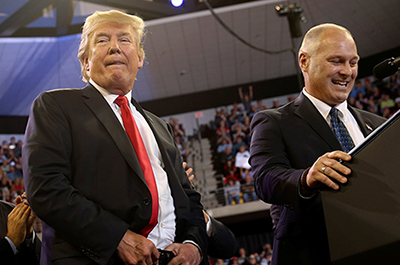 President Donald Trump shown onstage with then-candidate Pete Stauber