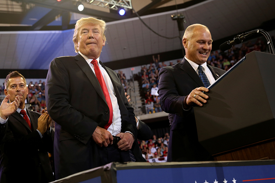 President Donald Trump shown onstage with then-candidate Pete Stauber, right, at a 2018 rally with supporters in Duluth.