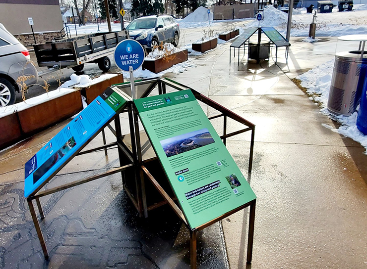 """""""We Are Water MN"""" outdoor exhibit, presented by We Are Water MN and the Hmong Museum."""