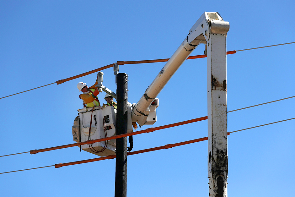 Workers installing a utility pole on Monday to support power lines in Houston, Texas.