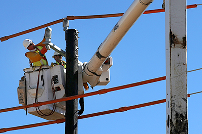Workers installing a utility pole
