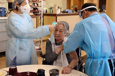 A nursing home resident receiving the coronavirus vaccine