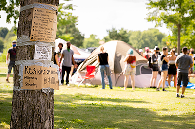 Signs on a tree located near the entrance to the Powderhorn East homeless encampment in south Minneapolis. The encampment was cleared by Minneapolis Police on July 21, 2020.