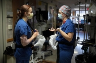 Nurse Kate Knepprath talks with nursing assistant Brittany Digman