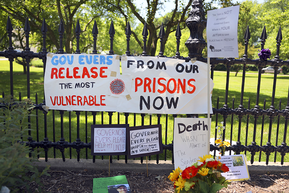 """Signs and posters are left outside the Wisconsin governor's mansion in Maple Bluff, Wisconsin, on June 18, 2020, as part of a """"Drive to Decarcerate"""" event."""