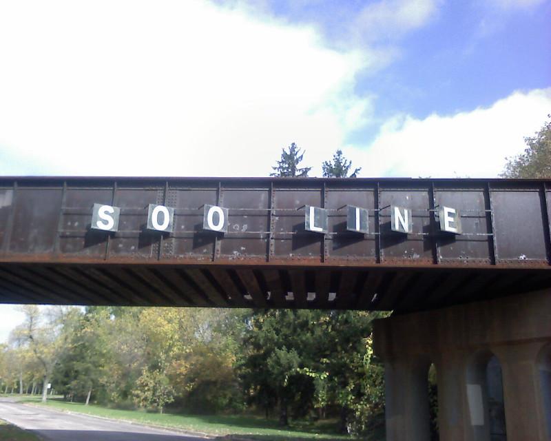 photo of rail bridge with soo line printed on it
