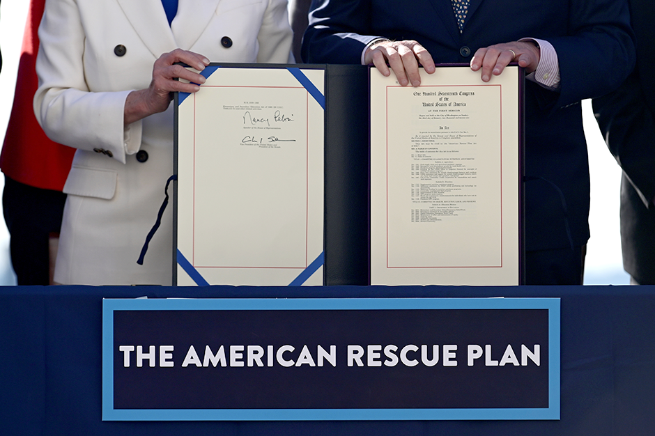 "House Speaker Nancy Pelosi and Senate Majority Leader Chuck Schumer display the ""American Rescue Plan"" following passage of President Joe Biden's $1.9 trillion coronavirus disease relief bill."