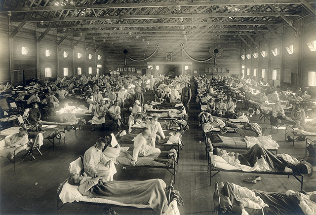 Soldiers from Fort Riley, Kansas, ill with Spanish flu at a hospital ward at Camp Funston.