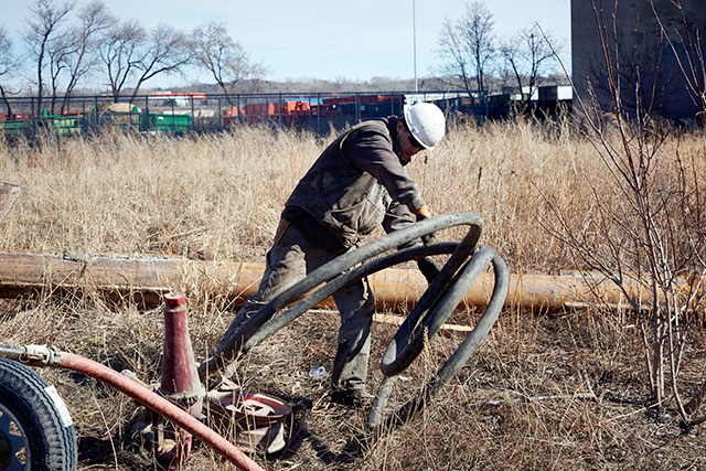 An engineer drilling down through a layer of sandstone to reach the underground Shakopee and Jordan aquifers.
