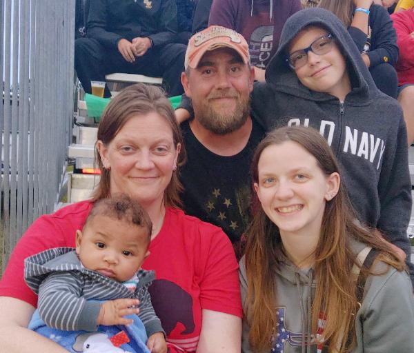 Tarah, left, and Eric Groettum, center, and family.