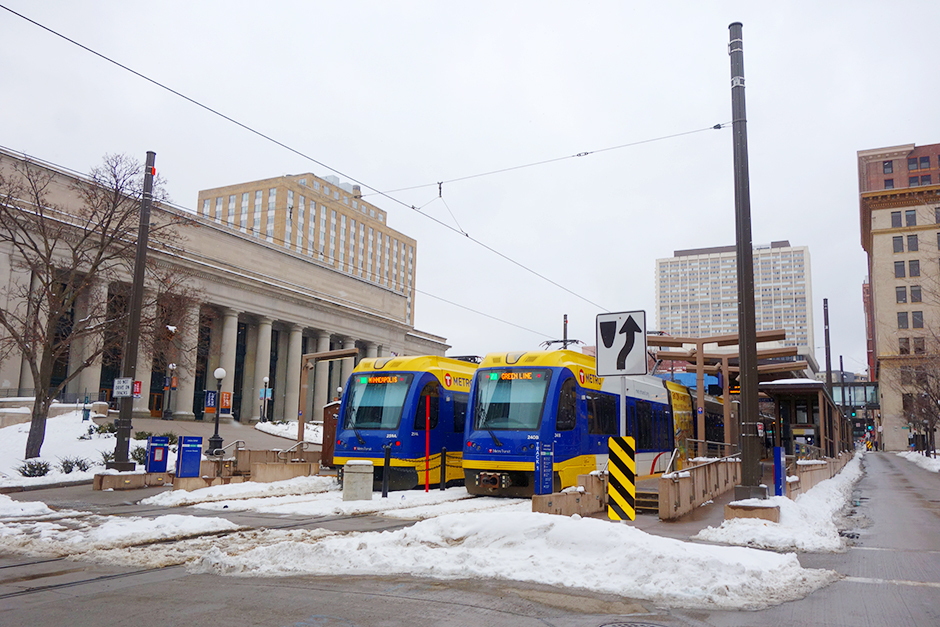 Green Line trains in front of the St. Paul Depot