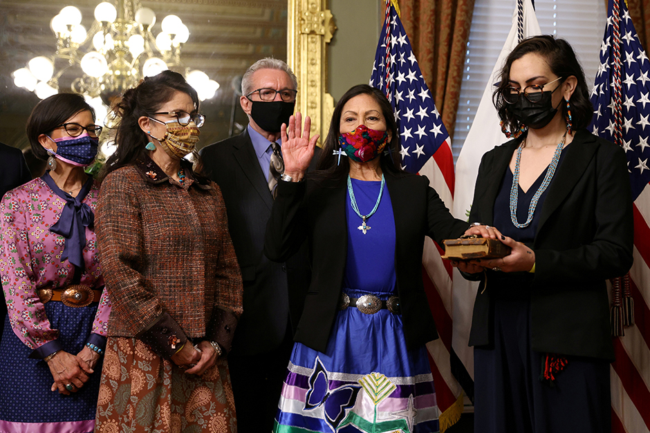 Somah Haaland holds a Bible for her mother, Interior Secretary Debra Haaland, during a ceremonial swearing-in at the White House on Thursday.