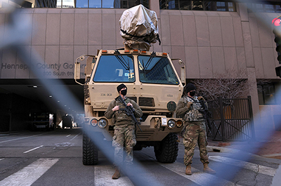 Members of the National Guard stand guard in front of the Hennepin County Government Center on March 8.