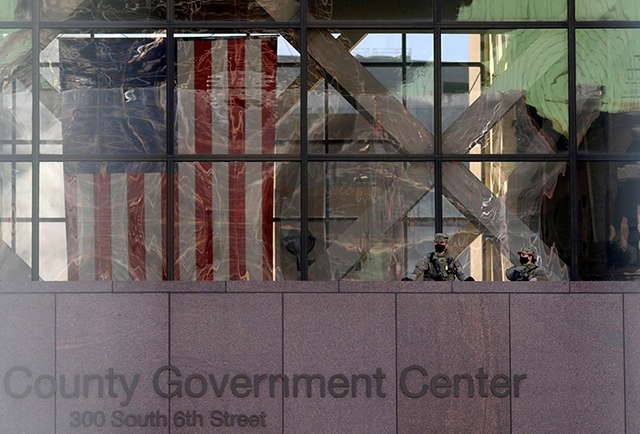 Members of the National Guard keep watch outside of the Hennepin County Government Center as jury selection continues in the trial of former Minneapolis police officer Derek Chauvin.