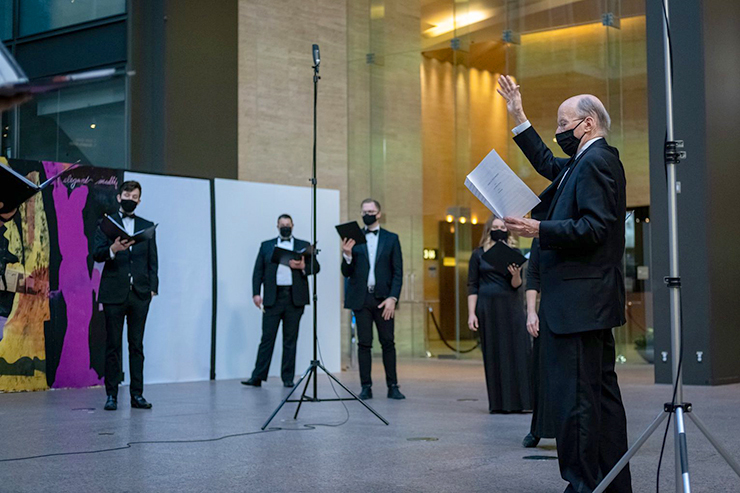 Philip Brunelle and the VocalEssence Ensemble Singers at the IDS Center.