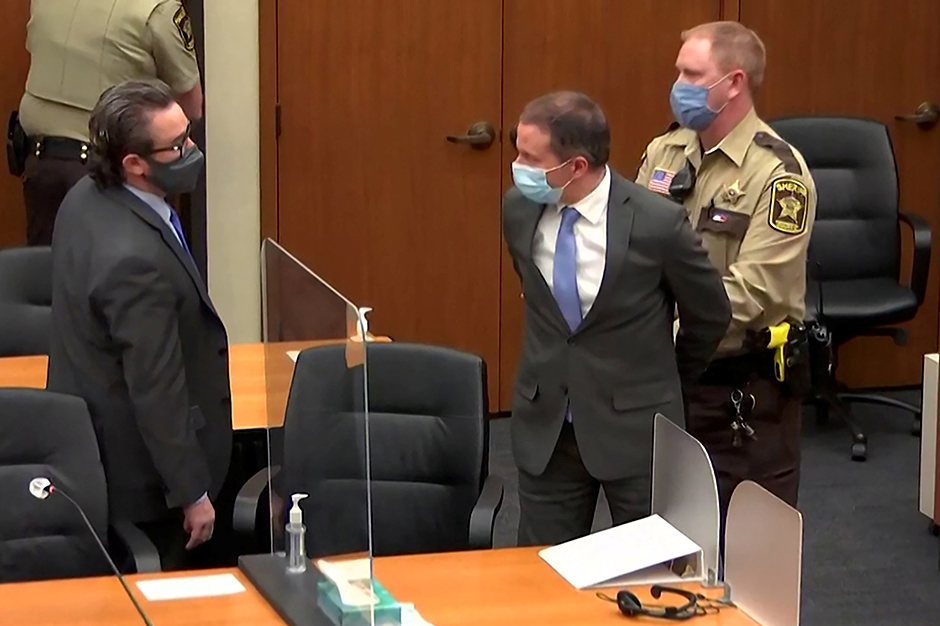 Former Minneapolis police officer Derek Chauvin shown being led away in handcuffs after a jury found him guilty of all charges on April 20.