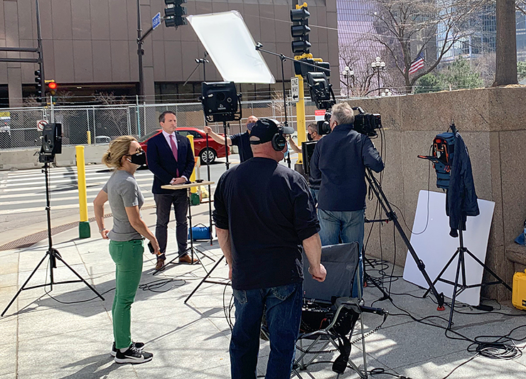 Media outside the government center Monday afternoon.