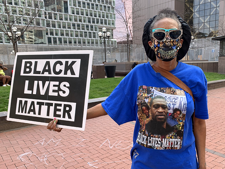 """""""The world is watching, right?"""": Lisa Avant outside the government center Monday afternoon."""