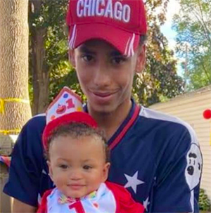 Daunte Wright holding his son, Daunte Jr., on his first birthday