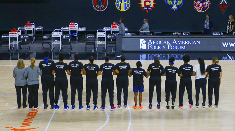 Minnesota Lynx players stand for a special Black Lives Matter presentation before a game against the Phoenix Mercury at the FELD Entertainment complex on September 17, 2020.