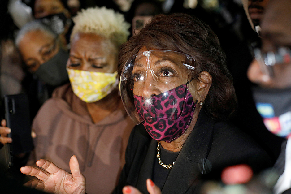 Rep. Maxine Waters speaking to the press while standing with protesters in front of the Brooklyn Center Police Department on April 17.